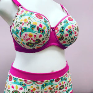Bra and panties made with a patterned fabric and pink bands